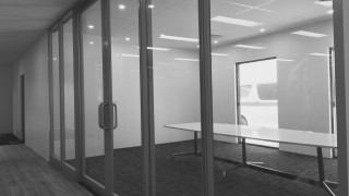 clear glass partition and door Kenwick office